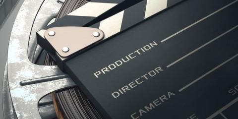 Filmklappe mit Filmrolle - Filme machen ohne Studium